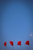 "Daytime vertical view of Chinese PRC flags on top of ""The Gate of Heavenly Peace"" in the Zijin Cheng from Dong Chang An Jie in Dongcheng, Beijing  © LAN"