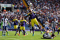 Pictured: Garteh McAuley of West Brom heads the ball from above Ashley Williams of Swanseafrom a cross by the later's team mate. Sunday 01 September 2013<br />