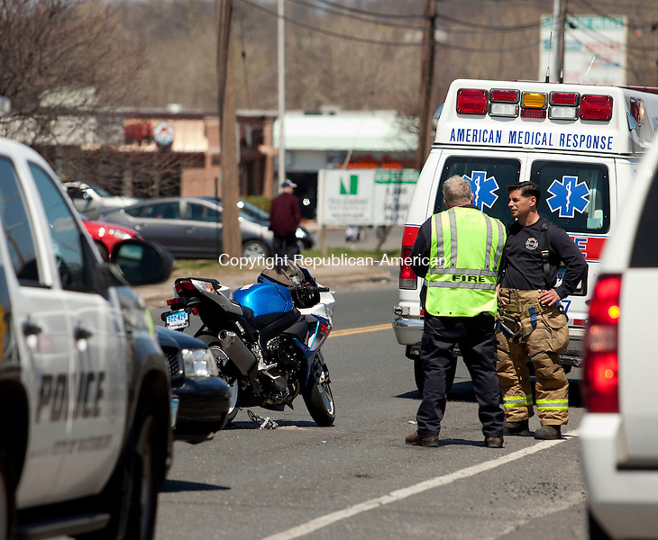 WATERBURY, CT-28 April 2014-042814BF02- Emergency personal from the Waterbury Police Department and the Waterbury Fire Department look over the scene of an accident on Thomaston Avenue Monday afternoon. The accident involved a motorcycle and car.  Bob Falcetti Republican-American