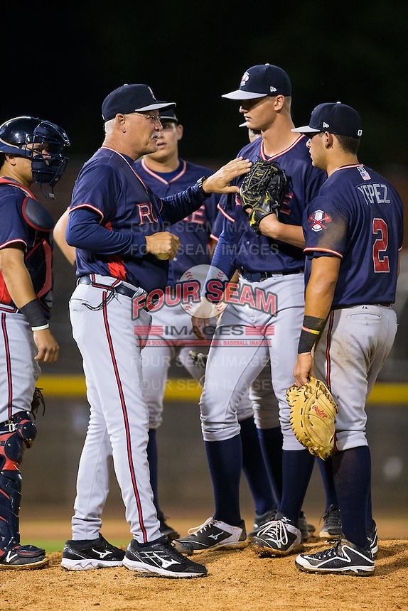 Rome Braves manager Randy Ingle (left) taps starting pitcher Mike Soroka (54) on the chest as he makes a pitching change during the game against the Hickory Crawdads at L.P. Frans Stadium on May 12, 2016 in Hickory, North Carolina.  The Braves defeated the Crawdads 3-0.  (Brian Westerholt/Four Seam Images)