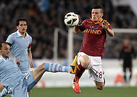 Calcio, Serie A: Roma vs Lazio. Roma, Stadio Olimpico, 8 aprile 2013..AS Roma midfielder Alessandro Florenzi is challenged by Lazio defender Stefan Radu, of Romania, left, during the Italian serie A football match between A.S. Roma  and Lazio at Rome's Olympic stadium, 8 april 2013..UPDATE IMAGES PRESS/Isabella Bonotto