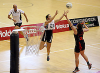29.09.2014 Counties Manukau's Caitlin Riedstra in action during the  Counties Manukau v Eastern Waikato duing the Lion Foundation Netball Champs at the Trusts Stadium in Auckland. Mandatory Photo Credit ©Michael Bradley.