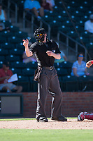Home plate umpire Alex Tosi calls a strike during an Arizona Fall League game between the Surprise Saguaros and the Salt River Rafters on October 9, 2018 at Surprise Stadium in Surprise, Arizona. Salt River defeated Surprise 10-8. (Zachary Lucy/Four Seam Images)