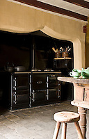 There is ample room for the large black enamel Aga in the inglenook fireplace of the kitchen