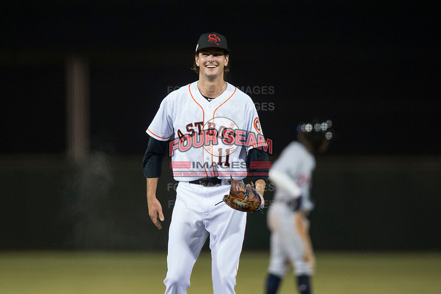 Scottsdale Scorpions starting pitcher Forrest Whitley (11), of the Houston Astros organization, laughs after being called for a balk during an Arizona Fall League game against the Mesa Solar Sox on October 9, 2018 at Scottsdale Stadium in Scottsdale, Arizona. The Solar Sox defeated the Scorpions 4-3. (Zachary Lucy/Four Seam Images)