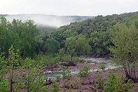 The wooded folds of the Ozark National Forest cradle mist on April 24 2020 along Arkansas 220.<br />