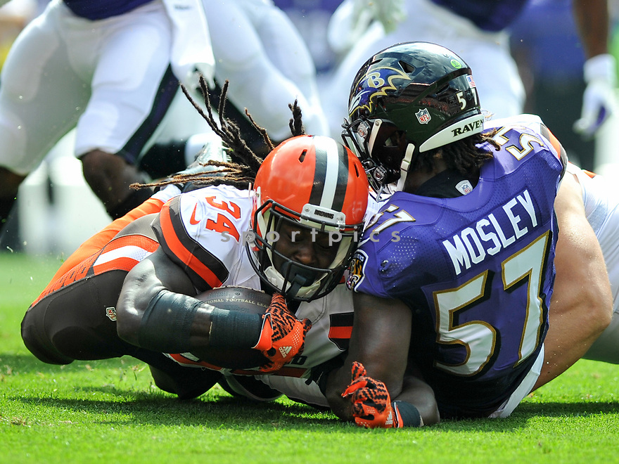 CLEVELAND, OH - JULY 18, 2016: Running back Isaiah Crowell #34 of the Cleveland Browns is tackled by linebacker C.J. Mosley #57 of the Baltimore Ravens in the first quarter of a game on July 18, 2016 at FirstEnergy Stadium in Cleveland, Ohio. Baltimore won 25-20. (Photo by: 2017 Nick Cammett/Diamond Images)  *** Local Caption *** Isaiah Crowell; C.J. Mosley(SPORTPICS)