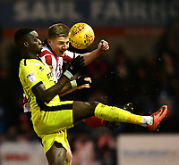 Lincoln City's Scott Wharton vies for possession with Cheltenham Town's Mohamed Eisa<br /> <br /> Photographer Chris Vaughan/CameraSport<br /> <br /> The EFL Sky Bet League Two - Lincoln City v Cheltenham Town - Tuesday 13th February 2018 - Sincil Bank - Lincoln<br /> <br /> World Copyright &copy; 2018 CameraSport. All rights reserved. 43 Linden Ave. Countesthorpe. Leicester. England. LE8 5PG - Tel: +44 (0) 116 277 4147 - admin@camerasport.com - www.camerasport.com