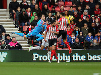 Pictured L-R: Lukasz Fabianski of Swansea saves the ball from an attack by Graziano Pelle and Dusan Tadic of Southampton  Sunday 01 February 2015<br />