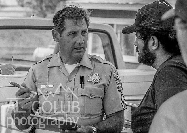 September 4, 1987 Greeley Hill, California -- Stanislaus Complex Fire  -- Mariposa County Sheriffs Department Sergeant Norm Ross coordinates community operations during fire in Greeley Hill.  The Stanislaus Complex Fire consumed 28 structures and 145,980 acres.  One US Forest Service firefighter, David Ross Erickson, died from a tree-felling accident.