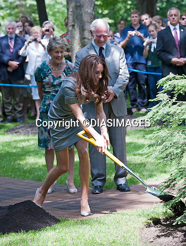 "WILLIAM & KATE TREE PLANTING.throw spades of earth on to a 2-year-old tree dedicated to their visit, inthe garden of the Governor General's residence, Rideau Hall, Ottawa_02/07/2011.Mandatory Credit Photo: ©DIASIMAGES..**ALL FEES PAYABLE TO: ""NEWSPIX INTERNATIONAL""**..IMMEDIATE CONFIRMATION OF USAGE REQUIRED:.DiasImages, 31a Chinnery Hill, Bishop's Stortford, ENGLAND CM23 3PS.Tel:+441279 324672  ; Fax: +441279656877.Mobile:  07775681153.e-mail: info@newspixinternational.co.uk"