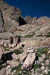 climbers, couple, hiking, Colorado columbine, Aquilegia coerulea, Longs Peak, morning, cairn, trail marker, landscape, Rocky Mountain National Park, Rocky Mountains, Colorado, USA