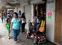 Shoppers hang out outside a snack vendor selling nachos and drinks along Main Street in downtown McAllen, Texas, Sunday, April 4, 2010. Downtown McAllen stores don't sell designer or name brand items, but still reach a wide customer base for McAllen residents and visiting Mexican tourists. ..PHOTO/ Matt Nager