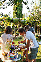 Young friends at a summer garden party