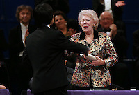 PICTURE BY VAUGHN RIDLEY/SWPIX.COM - Leeds International Piano Competition 2012 - Leeds Town Hall, Leeds, England - 15/09/12 - Dame Janet Baker presents Jiayan Sun of China with the 3rd place Award.