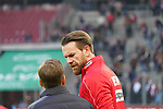 30.11.2019, RheinEnergieStadion, Koeln, GER, 1. FBL, 1.FC Koeln vs. FC Augsburg,<br />  <br /> DFL regulations prohibit any use of photographs as image sequences and/or quasi-video<br /> <br /> im Bild / picture shows: <br /> Horst Heldt Geschäftsführer / Geschaeftsfuehrer Sport (1.FC Koeln), unterhaelt sich mit Thomas Kessler Torwart (FC Koeln #18),       <br /> <br /> Foto © nordphoto / Meuter