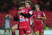 Kieran Hardy of Scarlets celebrates scoring his sides third try with tram mate Angus O'Brien during the European Rugby Challenge Cup Round 4 match between the Scarlets and Bayonne at the Parc Y Scarlets in Llanelli, Wales, UK. Saturday 14 December 2019