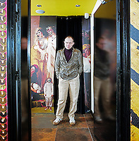 Designer Christian Lacroix stands in the entrance to the lounge at Le Bellechasse Hotel in Paris