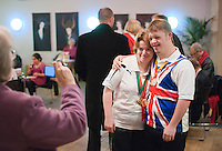 """Two athletes having their photo taken.   Special Olympics Surrey put on a show,   """"Beyond the Stars"""", at the Rose Theatre, Kingston upon Thames to raise money for the  SOGB team.  The Special Olympics are for athletes with learning disabilities."""