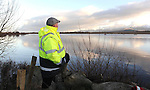 27-01-12: A local man looking out at at the White Sand Lake, Cromane, Co. Kerry on Friday during the search for Neilus O'Connor. . Mr O'Connor was missing after going out on a kayak on the lake in the early hours of Friday morning.   Picture: Eamonn Keogh (MacMonagle, Killarney)