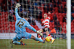 Doncaster Rovers v Yeovil Town, 14.2.2015<br /> Sky Bet League One<br /> Picture Shaun Flannery/Trevor Smith Photography<br /> Kyle Bennet beats Yeovil keeper Artur Krysiak to score Rovers 3rd goal.