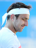Marinko Matosevic (Australia) during his match versus Marin Cilic (Croatia) - Aegon Tennis Championships - 10/06/14 - MANDATORY CREDIT: Rob Newell - Self billing applies where appropriate - 07808 022 631 - robnew1168@aol.com - NO UNPAID USE - BACS details for payment: Rob Newell A/C 11891604 Sort Code 16-60-51