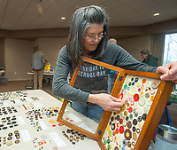 NWA Democrat-Gazette/BEN GOFF @NWABENGOFF<br /> Mariette Spidel of Huntsville shows her button collection Saturday, Jan. 12, 2019, during the annual collectors day 'Cabin Fever Reliever' at the Shiloh Museum of Ozark History in Springdale. Dozens of local collectors set up tables showcasing their collections of such various things as kitchen utensils, coins, buttons, hand fans, fossils woodcarving and much more.