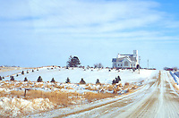 Country church in the wintery fields of Iowa.  Garden City Iowa USA