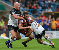 Huddersfield Giants's Shannon Wakeman is tackled by Widnes Vikings's Stefan Marsh and Hep Cahill<br /> <br /> Photographer Alex Dodd/CameraSport<br /> <br /> Betfred Super League Round 21  - Huddersfield Giants v Widnes Vikings - Friday 7th July 2017 - John Smith's Stadium - Huddersfield<br /> <br /> World Copyright &copy; 2017 CameraSport. All rights reserved. 43 Linden Ave. Countesthorpe. Leicester. England. LE8 5PG - Tel: +44 (0) 116 277 4147 - admin@camerasport.com - www.camerasport.com