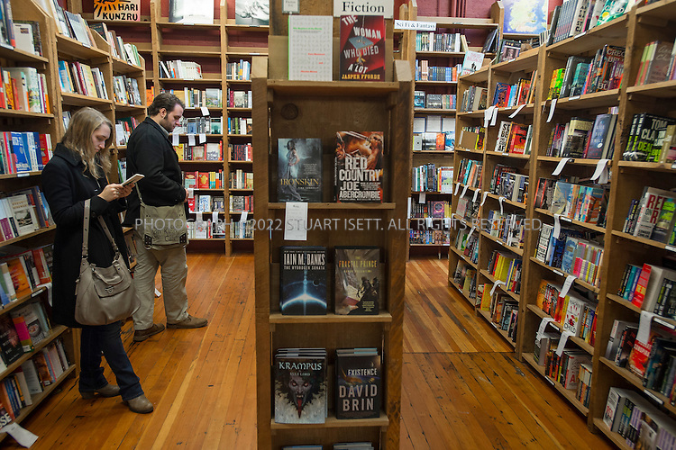 12/13/2012--Seattle, WA, USA..Madeleine Bergeron and David Ritter, both from Vancouver, Canada browsing for books at Elliot Bay Book Store...Elliot Bay book store in Seattle's Capitol Hill neighborhood is one of the city's most popular independent book stores...©2012 Stuart Isett. All rights reserved.
