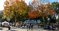 People attend the Dane County Farmers' Market, as the trees display their fall colors in front of the State Capitol Building  on Saturday, October 17, 2015 in Madison, Wisconsin