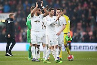Swansea players applaud the fans after the Barclays Premier League match between AFC Bournemouth and Swansea City played at The Vitality Stadium, Bournemouth on March 12th 2016