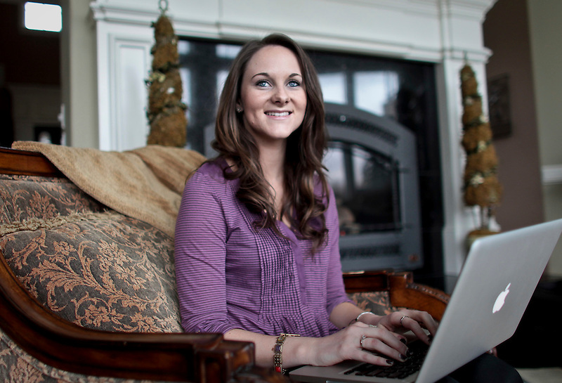 Kelsey Russell works on her Facebook page at her Vancouver home, Tuesday march 22, 2001. Russell is the face of and the inspiration behind the character Bailey Flanigan. She has a Facebook page where she gives advice to fans and interacts with them as the character.
