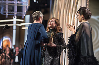 Isabelle Huppert and Angelina Jolie present the Golden Globe award for Best Actress in a Motion Picture, Drama to actress Frances McDormand for her role in &quot;Three Billboards Outside Ebbing, Missouri,&quot; at the 75th Annual Golden Globes Awards to at the Beverly Hilton in Beverly Hills, CA on Sunday, January 7, 2018.<br /> *Editorial Use Only*<br /> CAP/PLF/HFPA<br /> &copy;HFPA/PLF/Capital Pictures