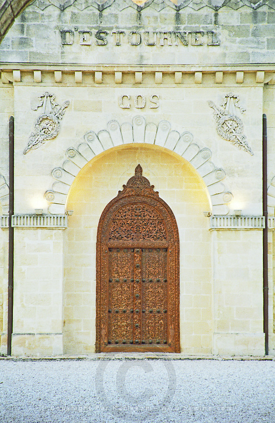 Ornate carved wooden door. Faux oriental style. Chateau Cos d'Estournel, Saint Estephe. Medoc, Bordeaux, France