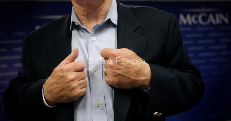 In his first visit to the state since June, U.S. Presidential hopeful John McCain (R-AZ) clenches his fists after holding a press conference in his headquarters in Urbandale, IA, on July 22, 2007. McCain declared his presidential campaign would go on, despite losing several aides and $1.7 million to debt.