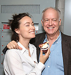 Olivia Wilde and Reed Birney from the cast of Broadway's '1984' celebrate their 101st performance (in honor of the show's notorious Room 101) with red velvet cupcakes with severed finger toppings on September 17, 2017 at the Hudson Theatre in New York City.