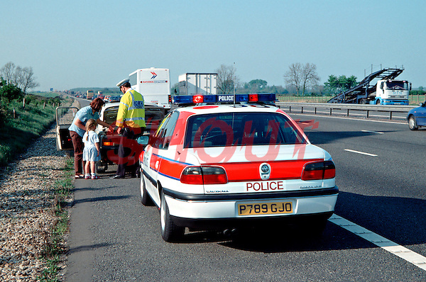 Police rapid response traffic vehicle dealing with a car containing a family that has broken down on the hard shoulder of the motorway. This image may only be used to portray the subject in a positive manner..©shoutpictures.com..john@shoutpictures.com