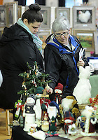 DOYLESTOWN, PA - NOVEMBER 1: Meghan Braun and her mother Becca Braun of Doylestown, Pennsylvania browse Christmas decorations at the Our Lady of Mount Carmel Holiday Craft Fair  November 1, 2014 in Doylestown, Pennsylvania. Proceeds from this fundraising event will benefit Our Lady of Mount Carmel School. (Photo by William Thomas Cain/Cain Images)