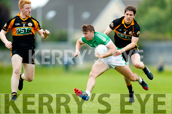 Barry Walsh and Ronan Shanahan Austin Stacks in action James O'Donoghue Legion in the Kerry Senior Football Championship on Friday Night.