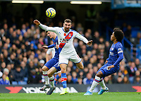 9th November 2019; Stamford Bridge, London, England; English Premier League Football, Chelsea versus Crystal Palace; James McArthur of Crystal Palace heads the ball out of danger past Willian and Mason Mount of Chelsea - Strictly Editorial Use Only. No use with unauthorized audio, video, data, fixture lists, club/league logos or 'live' services. Online in-match use limited to 120 images, no video emulation. No use in betting, games or single club/league/player publications