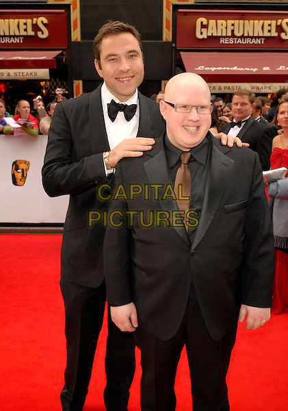 DAVID WALLIAMS & MATT LUCAS.Red Carpet Arrivals at The British Academy Television Awards (BAFTA) Sponsored by Pioneer, held at the London Palladium, London, England, May 20th 2007..half 3/4 length hands on shoulders black suits bow tie tuxedo brown tie.CAP/FIN.©Steve Finn/Capital Pictures.