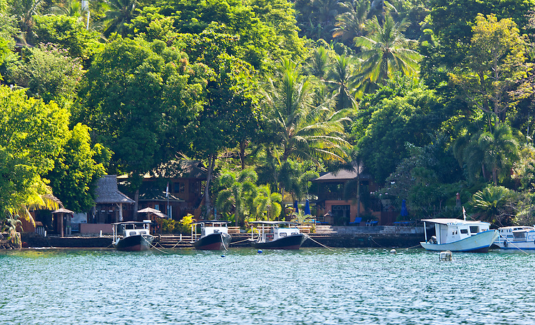 The pool, dive shop, and restaurant are gathered around the moorings in the center of the Lembeh Resort, Lembeh Island, off North Sulawesi, Indonesia.