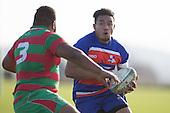 Luteru Laulala charges towards Joe Harwood. Counties Manukau Premier Club Rugby game between Waiuku and Ardmore Marist, played at Waiuku on Saturday June 4th 2016. Ardmore Marist won 46 - 3 after leading 39 - 3 at Halftime. Photo by Richard Spranger.