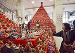 """February 17, 2013, Konosu, Japan - A visitor takes a closer look at Girls' Fewstival ornamental dolls displayed on the red-carpeted platform in a huge pyramid shape at the lobby of Konosu city hall, north of Tokyo, on Sunday, February 17, 2013. The dolls numbered 18,000 represent emperor, empress, attendants and musicians in the ancient Imperial court. The city of Konosu, situated some 40 km north of Tokyo, is known as """" the doll town"""" for a number of factories manufacturing Japanese dolls. Japanese tradition calls upon families with daughters for putting out dolls for the Girls Day on March 3 with the hopes that they grow up healthy and happily. (Photo by Natsuki Sakai/AFLO) AYF -mis-."""