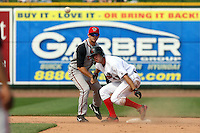June 15th 2008:  Second baseman John Tolisano of the Lansing Lugnuts, Class-A affiliate of the Toronto Blue Jays, turns two as Erik Kanaby slides in during a game at Dow Diamond in Midland, MI.  Photo by:  Mike Janes/Four Seam Images