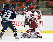 Kevin McCarey (UNH - 23), Danny Fick (Harvard - 7), Steve Michalek (Harvard - 34) - The Harvard University Crimson defeated the University of New Hampshire Wildcats 7-6 on Tuesday, November 22, 2011, at Bright Hockey Center in Cambridge, Massachusetts.