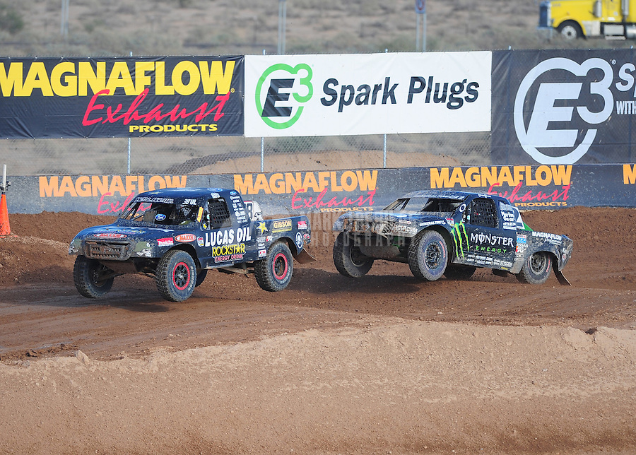 Dec. 11, 2011; Chandler, AZ, USA;  LOORRS pro lite driver Brian Deegan (38) and Casey Currie (2) during the Lucas Oil Challenge Cup at Firebird International Raceway. Mandatory Credit: Mark J. Rebilas-