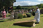 Stowey Female Friendly Society ( The Womens Walk ) Club Day. Local women and flower girls walk from the village to the grave of Tom Poole, the founder of the society in 1806. The Rev Craig Marshall, St Mary's Church, where a prayer is said around the grave, followed by a church service. <br />
