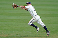 3 March 2013:  FIU infielder/outfielder Tyler James Shantz (5) leaps after the ball as the University of Mississippi Ole Miss Rebels defeated the FIU Golden Panthers, 8-1, at University Park Stadium in Miami, Florida.
